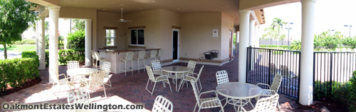 the shaded patio area behind the Oakmont Estates clubhouse provides a wet bar and is an excellent place to entertain.